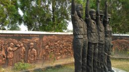 A sculpture in Sintang shows soldiers saluting