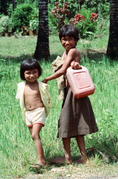 Juliana and her sister fetch water, 1991