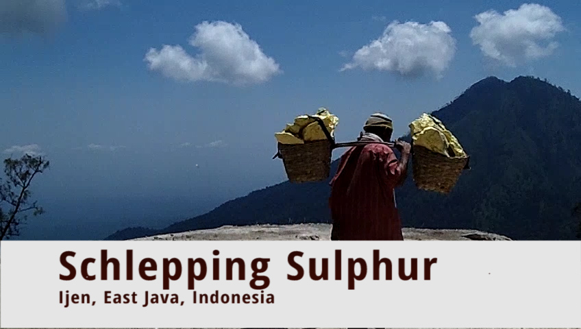 Schlepping sulphur: miners collect sulphur with their bare hands at the Ijen volcano in East Java, Indonesia