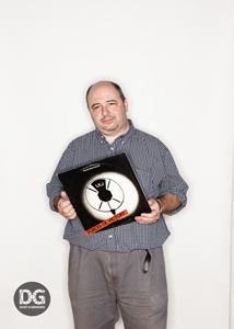 Mark, with a favourite record. Photo by: Eilon Paz for Dust & Grooves