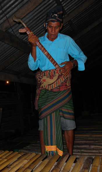 Getting dressed with sword for a traditional ceremony in Sumba, Indonesia