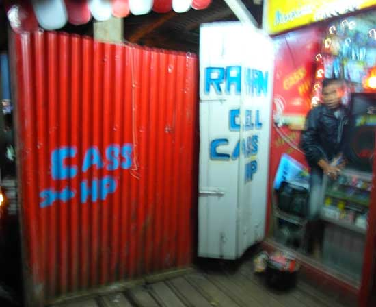 A shop offering phone charging services in Enarotali, Indonesian Papua