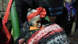 A dead grandmother receives guests before her funeral in Sumba, Indonesia