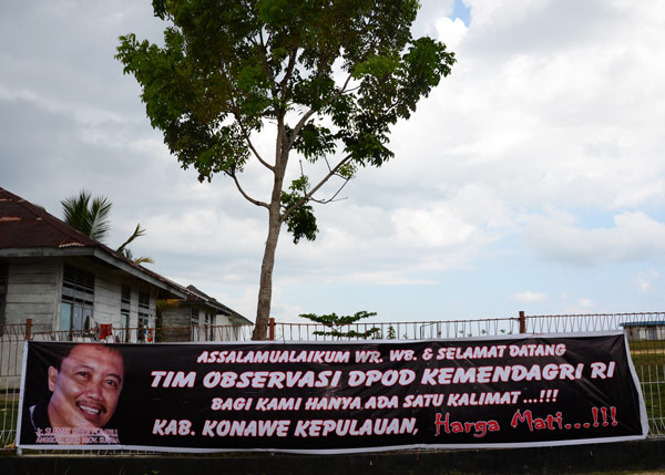 "A banner demands a new Indonesian district, ""At All Costs"""