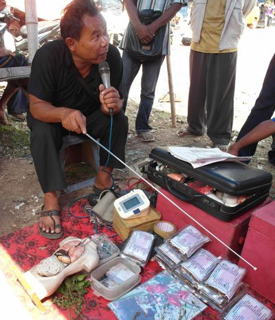 Medicine man in a market in Boawae, Flores, Indonesia