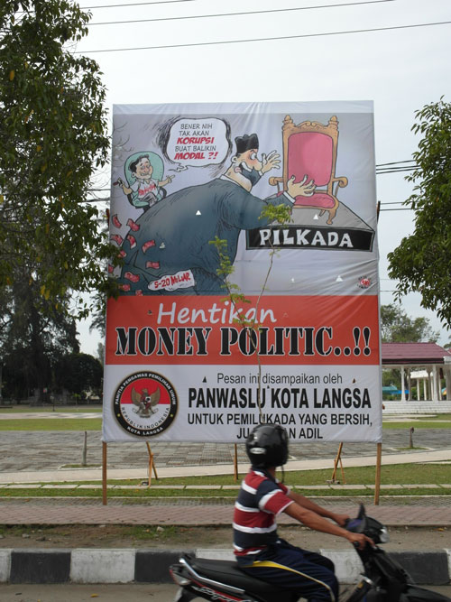 A poster in Aceh, Indonesia warns that selling votes leads to corruption