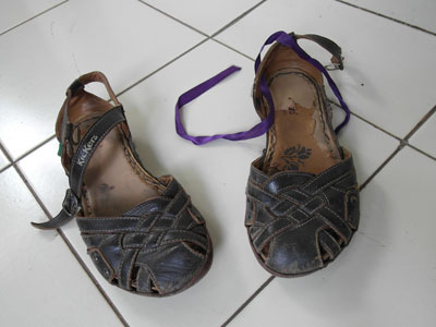 Elizabeth's sandals, with purple ribbon