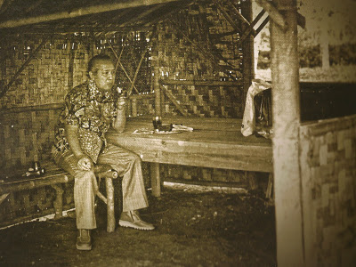 Indonesian President Suharto sits in a rural coffee shop