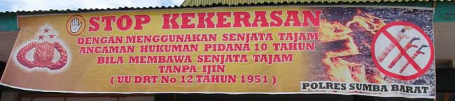 A banner discouraging people in Sumba, Indonesia, from carrying deadly weapons